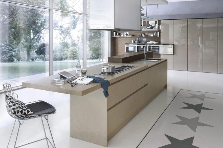 Полуостров на кухне с мойкой и плитой