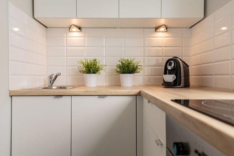 Разнообразить внешний вид кухни помогают  оригинальные светильники и предметы декора