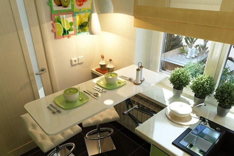 В маленькой кухне барную стойку разумнее совместить с обеденным столиком