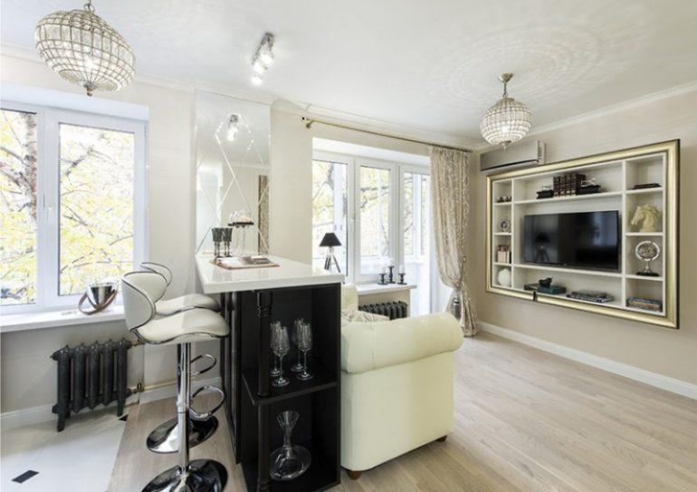 А вот пример реконструкции двух помещений в одну кухню-гостиную