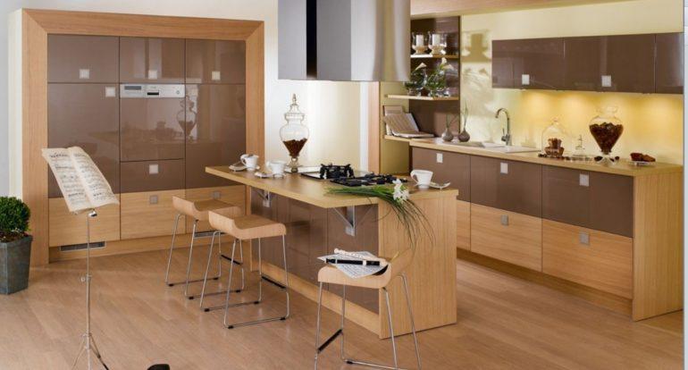 Пример кухонного острова с барной стойкой и встроенной варочной поверхностью