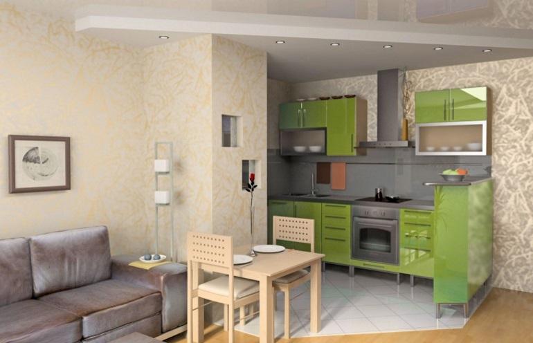 Зеленый гарнитур и выступ в стене в роли разделителя кухонного пространства
