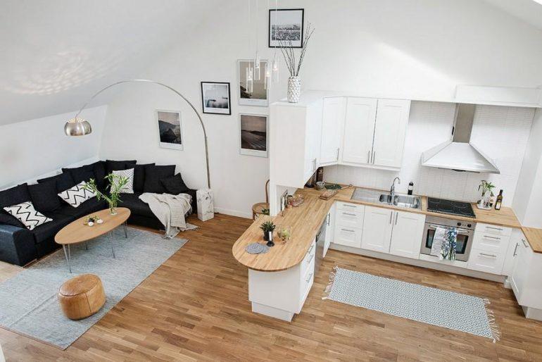 Оригинальная барная стойка будет выполнять эстетическую функцию и станет главным элементом декора кухни-гостиной