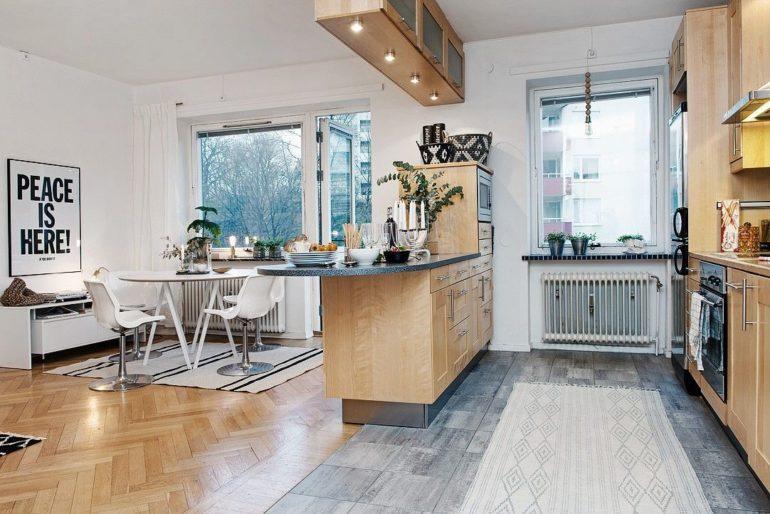 Барная стойка легко справится с задачей разделения кухни на функциональные зоны